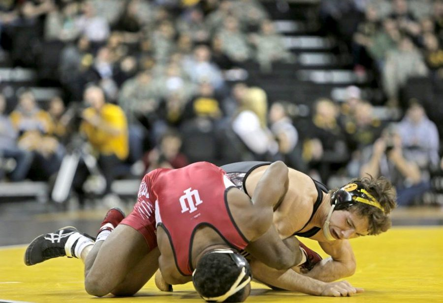 Iowa+junior+Thomas+Gilman+attempts+to+hold+down+Indiana+freshman+Elijah+Oliver+at+the+Iowa+vs.+Indiana+Wrestling+match+inside+Carver-Hawkeye+on+Friday%2C+Feb.+5%2C+2016.+Iowa+defeated+Indiana%2C+45-0.+%28The+Daily+Iowan%2FCourtney+Hawkins%29