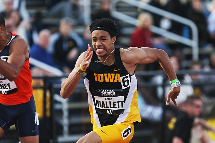 Iowa+runner+Aaron+Mallett+pushes+to+the+finish+line+in+the+men%27s+110+meter+hurdles+at+the+Iowa+Musco+Invitational+in+Iowa+City+on+Saturday%2C+May+3.+Mallett+placed+first+in+the+event.+%28The+Daily+Iowan%2FRachael+Westergard%29
