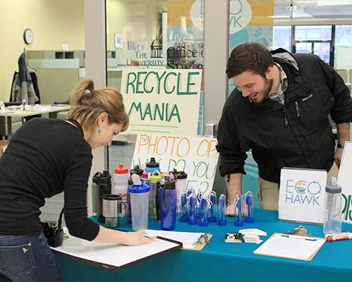 Tara Slade and Dane Williamson advocate Recycle Mania sponsored by the Office of Sustainability in the Old Capital Mall on Wednesday, March 23. We currently divert about 48% of our waste from landfill through recycling and compost. (The Daily Iowan/McCall Radavich)