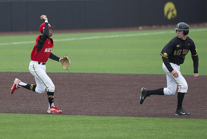 Maryland+infielder+AJ+Lee+chases+after+Iowa+player+for+the+tag+out+at+Duane+Banks+Field+on+Saturday%2C+March+26%2C+2016.+The+Hawkeyes+erased+a+1-0+deficit+in+the+bottom+of+the+8th+scoring+4+runs+to+beat+the+Terrapins+4-1.+%28The+Daily+Iowan%2F+Alex+Kroeze%29