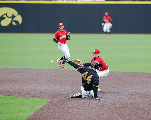 Iowa outfielder Robert Neustrom slides into second base at Duane Banks Field on Saturday, March 26. The Hawkeyes beat the Terrapins 4-1. (The Daily Iowan/ Alex Kroeze)