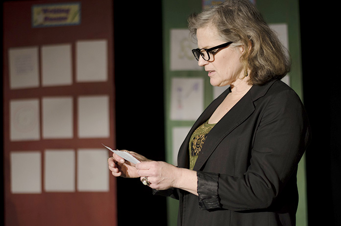 Corryn, Gidions mother played by Doreen Loring, reads a note that was given to her son by a girl. The play Gidions Knot will be preformed in Public Space One on March 4, 5, 11, and 12 at 7:30. (The Daily Iowan/Karley Finkel)