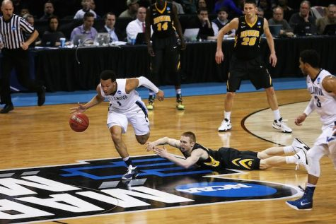 Iowa's Mike Gesell watches as Villanova's Jalen Brunson runs out a fast break. The Wildcats beat the Hawkeyes 87-68 on March 20 at the Barclays Center in Brooklyn, New York (Daily Iowan/Josh House)