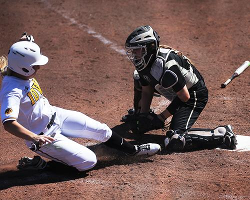 Iowa outfielder Sammi Gyerman gets tagged out at home by Purdue catcher Heather Knight during game three of the Iowa-Purdue series at Bob Pearl Field on Sunday, April 3, 2013. The Hawkeyes won over the Boilermakers, 10-3. (The Daily Iowan/Margaret Kispert)