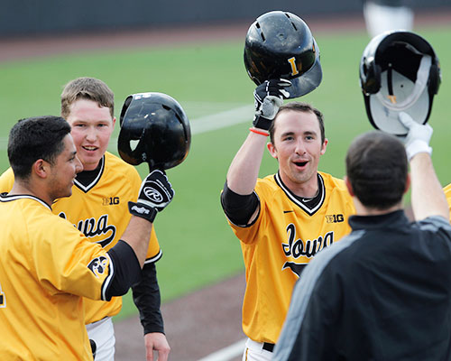 Iowa infielder Mason McCoy celebrates with teammates after a home run at Duane Banks Field on Wednesday, April 6, 2016. The Hawkeyes beat the Panthers 9-1. (The Daily Iowan/ Alex Kroeze)