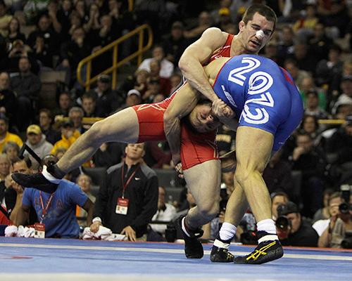 Brent Metcalf (red) wrestles Jared Frayer (blue) in the finals of the Team USA 2012 Olympic Wrestling Trials at Carver-Hawkeye Arena on Sunday, April 22, 2012. Frayer defeated Metcalf in 2 rounds to earn a place on the 2012 U.S. Olympic team. (The Daily Iowan/File Photo)