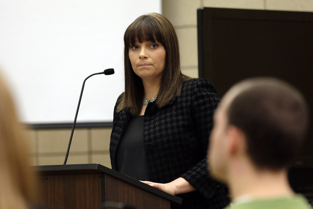 Assistant Johnson County Attorney Naeda Elliott looks at the defendant while giving the prosecution's opening statement in the trial of Alexander Kozak at the Story County Courthouse in Nevada on Thursday, April 14, 2016. Kozak is charged with first-degree murder in connection with the 2015 shooting death of Andrea Farrington at the Coral Ridge Mall. (Pool photo by Liz Martin/The Gazette)