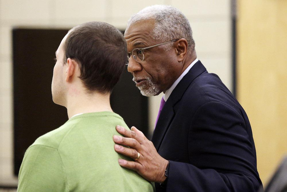 Alexander Kozak talks with defense attorney Alfredo Parrish after the prosecution's opening statement in in Kozak's trial at the Story County Courthouse in Nevada on Thursday, April 14, 2016. Alexander Kozak is charged with first-degree murder in connection with the 2015 shooting death of Andrea Farrington at the Coral Ridge Mall. (Pool photo by Liz Martin/The Gazette)