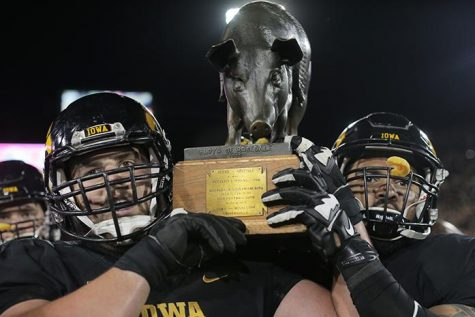 Iowa players carry Floyd the big off the field during the Iowa-Minnesota game at Kinnick on Saturday, Nov. 14, 2013. The Hawkeyes defeated the Golden Gophers, 40-35 to stay perfect on the season. (The Daily Iowan/File photo)