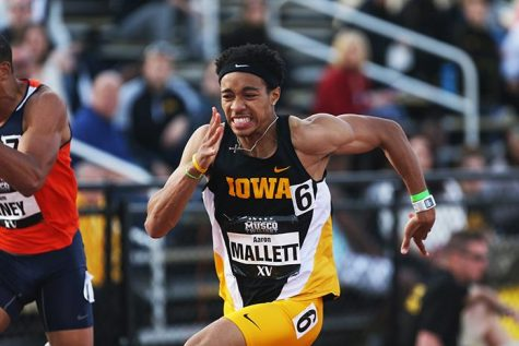 Iowa runner Aaron Mallett pushes to the finish line in the men