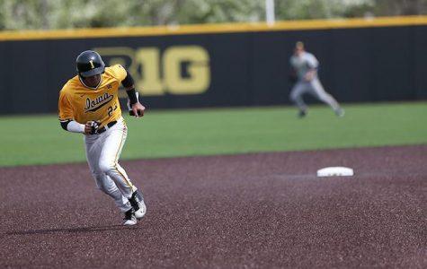 Bats erupt, Hawks avert sweep