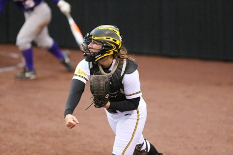 Iowa catcher Holly Hoffman throws down to second base at Pearl Field on Wednesday, April 30, 2014. The Hawkeyes lost to UNI in a close game 9-8. (The Daily Iowan/Valerie Burke)