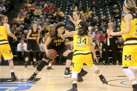 Iowa forward Megan Gustafson tries to drives down the lane full of Michigan defenders during Game 3 of the Women's Big Ten tournament in Bankers Life Fieldhouse in Indianapolis on Thursday, March 3, 2016. The Hawkeyes defeated the Wolverines, 97-85. Iowa will play #1 ranked Maryland tomorrow, March 4 at 1 p.m. Central Time. (The Daily Iowan/Margaret Kispert)