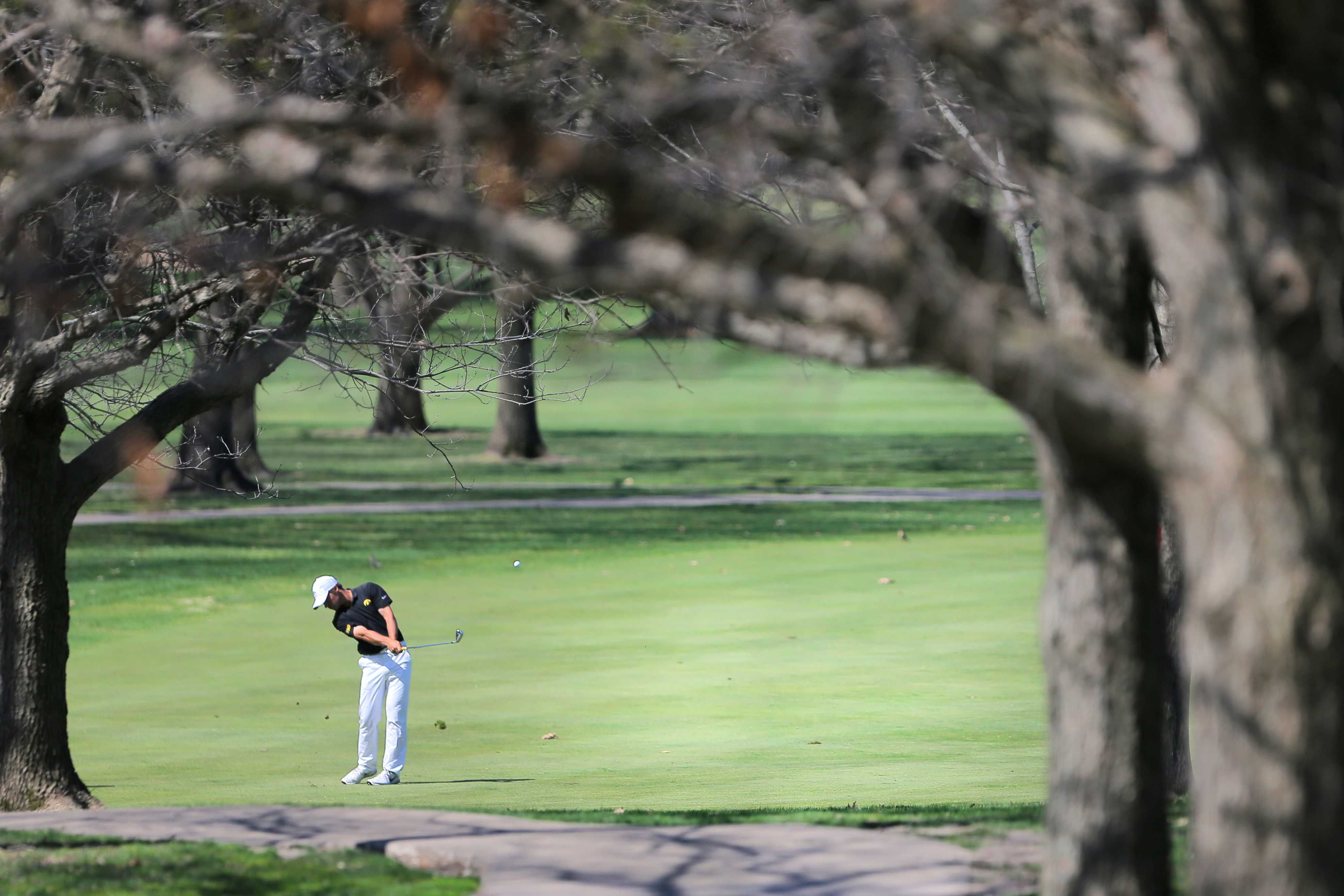 Iowa golfer Carson Schaake hits the ball off the fairway during the Iowa Invitational at Finkbine Golf Course on Sunday, April 17, 2016.
