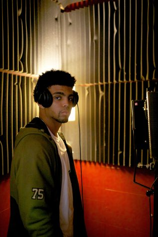 Omar Truitt records in his studio, downtown Iowa City on Tuesday, May 10, 2016. Truitt is a former Hawkeye football player. (The Daily Iowan/Mary Mathis)