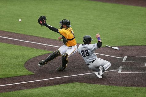 Iowa catcher Daniel Aaron Moriel tries to tag Kansas state first baseman Jake Scudder at home during game three of the Iowa-Kansas State series at Duane Banks field on Sunday, May 1, 2016. The Wildcats defeated the Hawkeyes, 4-2 taking the series. (The Daily Iowan/Margaret Kispert)