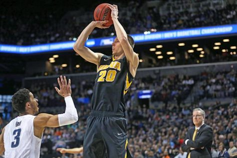 Iowa Hawkeyes forward Jarrod Uthoff (20) shoots a three point shot against Villanova Wildcats guard Josh Hart (3) in the Barclays Center on Sunday, March 20, 2016 in Brooklyn, New York. Uthoff ended the game with 6 rebounds, 16 points, and 2 assists. The Wildcats defeated the Hawkeyes, 87-68.