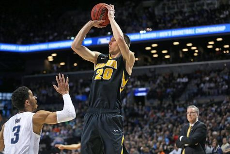 Iowa Hawkeyes forward Jarrod Uthoff (20) shoots a three point shot against Villanova Wildcats guard Josh Hart (3) in the Barclays Center on Sunday, March 20, 2016 in Brooklyn, New York. Uthoff ended the game with 6 rebounds, 16 points, and 2 assists. The Wildcats defeated the Hawkeyes, 87-68. (The Daily Iowan/Joshua Housing)