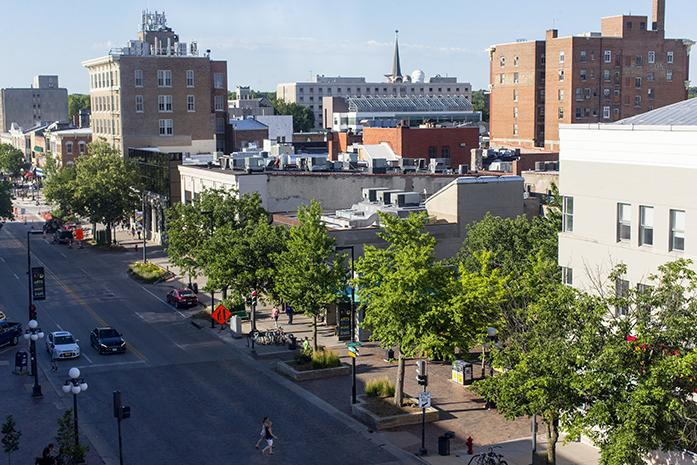 Pedestrians cross Clinton St. and enter the Pedestrian Mall in Downtown Iowa City on Monday June 27, 2016. Downtown Iowa City is currently undergoing changes to make the area more family friendly.  (The Daily Iowan/Joshua Housing)