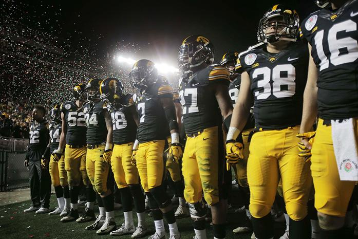 The Iowa football team joins hands for the last time this season after the Rose Bowl Game at Rose Bowl Stadium in Pasadena, California on Friday, Jan. 1, 2016. Stanford defeated Iowa, 45-16. (The Daily Iowan/Margaret Kispert)