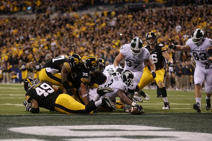 Michigan State running back LJ Scott scores a touchdown putting them in the lead with 27 seconds left in the fourth quarter during the Big Ten Championship against Michigan State in Lucas Oil Stadium in Indianapolis, Indiana on Saturday, Dec. 5, 2015. The Spartans defeated the Hawkeyes, 16-13. (The Daily Iowan/Alyssa Hitchcock)