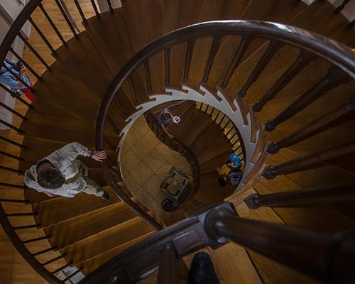 People walk down the spiral staircases of the Old Capitol on Sunday, July 3, 2016.