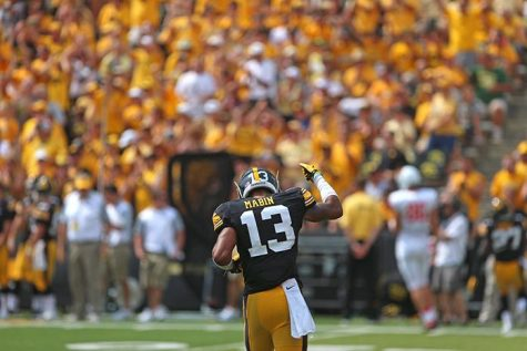 Iowa defensive back Greg Mabin runs to the sidelines in Kinnick Stadium on Saturday, Sept. 5, 2015. The Hawkeyes defeated the Redbirds, 31-14.