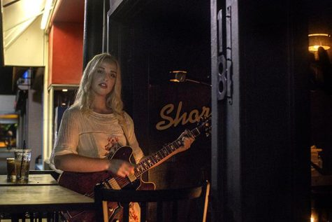 Elizabeth Moen plays guitar while performing inside Shorts Burger & Shine on Clinton Street on Sunday, July 31, 2016. Moen frequently plays an indie folkrock soul set at Shorts on Sunday nights. (The Daily Iowan/Joseph Cress)