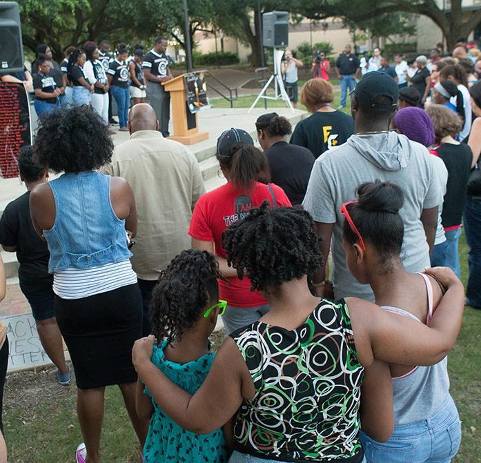 The+NAACP+at+McNeese+State+University+in+Lake+Charles%2C+La.%2C+held+a+prayer+vigil+on+Tuesday%2C+July+12%2C+2016%2C+in+the+Quad+on+campus.+The+vigil+was+to+promote+unity+and+equality+and+comes+in+the+wake+of+recent+shootings+in+Baton+Rouge%2C+Dallas%2C+and+Minnesota.+%28Rick+Hickman%2FLake+Charles+American+Press+via+AP%29