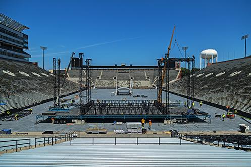 Personnel set up the stage in preparation for this weekend's Black Porch Revival Concert In Kinnick Stadium on Wednesday, Aug. 24, 2016. The concert will have Blake Shelton as the headlining act and serves as a fundraiser for the Native Fund. (The Daily Iowan/Anthony Vazquez)