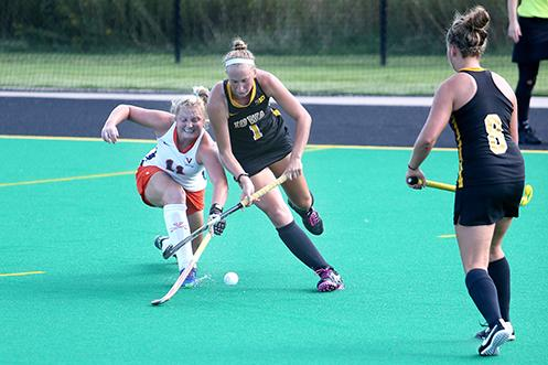 Iowa back Chandler Ackers and Virginia midfielder Lucy Hyams fight for the ball at Grant Field on Thursday, Sept. 4, 2014. The Hawkeyes beat the Cavaliers, 4-3. (The Daily Iowan/John Theulen)