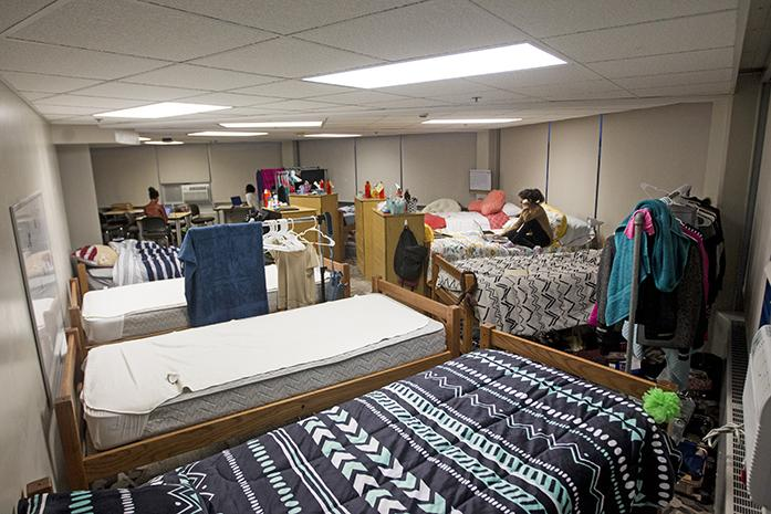 Mariel Alanis shares her space with seven other people Tuesday August 23, 2016. With so many people, privacy can be a potential problem. (The Daily Iowan/Vivian Le)