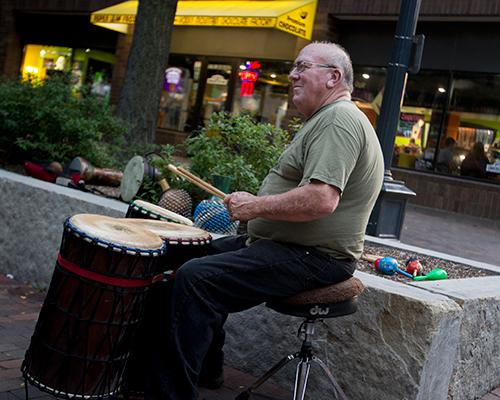 Mike Whittaker of The Yahoo Drummers jams out on the Pedestrian Mall on Tuesday August 30, 2016. Whittaker is playing the African djun-djun. (The Daily Iowan/Vivian Le)