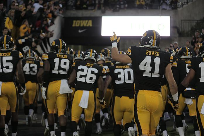 Iowa line backer Bo Bower points to the crowd as the team runs in after the game against Maryland in Kinnick Stadium on Oct. 31, 2015. The Hawkeyes defeated the Terrapins to stay undefeated, 31-15. (The Daily Iowan/Alyssa Hitchcock)