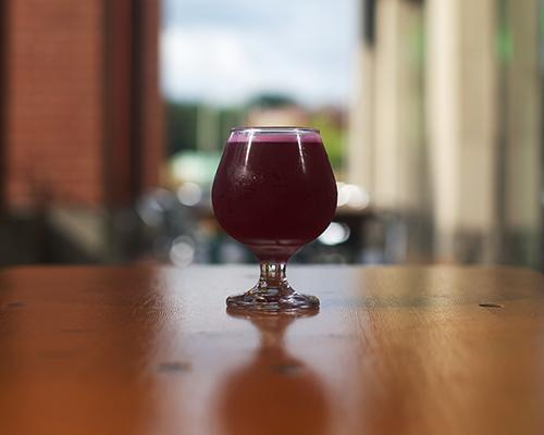 A glass of beet-orange-lyme Kombucha is shown on Brew Lab's patio on Tuesday, Aug. 30, 2016.  Wild Culture Kombucha, owned by Rachelle Schmidt and Tim Roed, is a fairly new business with multiple locations including 30 Hop, Pullman and Trumpet Blossom. (The Daily Iowan/Brooklynn Kascel)