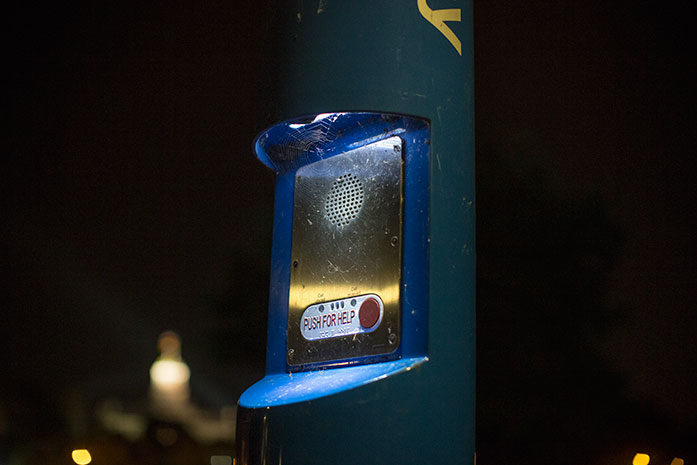 A blue cap illuminates a help call button alongside a pathway near Hubbard Park on Monday, September 5, 2016.  The blue caps are located in various areas of campus. (The Daily Iowan/Joseph Cress)