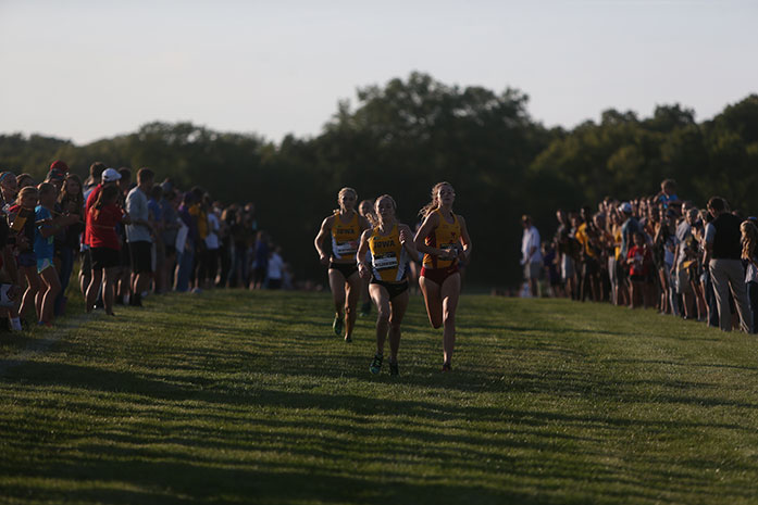 Iowa's Tess Wilberding races to the finish line followed by Iowa State's Grace Gibbson and Hawkeye Madison Waymire during the Hawkeye Invitational at the Ashton Cross-Country on Sept. 2. Wiberding finished first with a time of 10:20.4 to help the Hawkeyes take first. (The Daily Iowan/Margaret Kispert)
