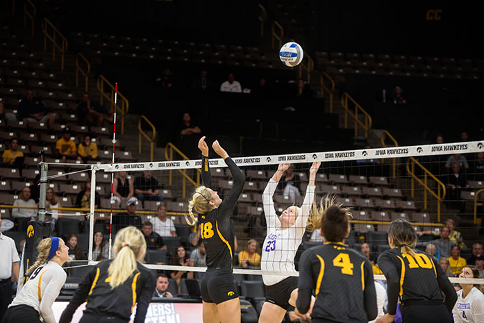 Iowa's no. 18 Lauren Brobst sets up a block during a volleyball match at the Carver Hawkeye Arena in Iowa City on Friday, Sept. 2 , 2016. Iowa defeated Western Illinois 3-1. (The Daily Iowan/Ting Xuan Tan)