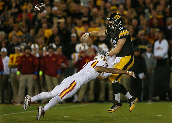 Iowa quarterback C.J. Beathard gets the pass out before Iowa State defensive end D'Andre Payne sacks him during the Iowa-Iowa State game at Kinnick on Saturday, Sept. 10, 2016. Iowa head Iowa State to one field goal to defeated them, 45-3. (The Daily Iowan/Margaret Kispert)