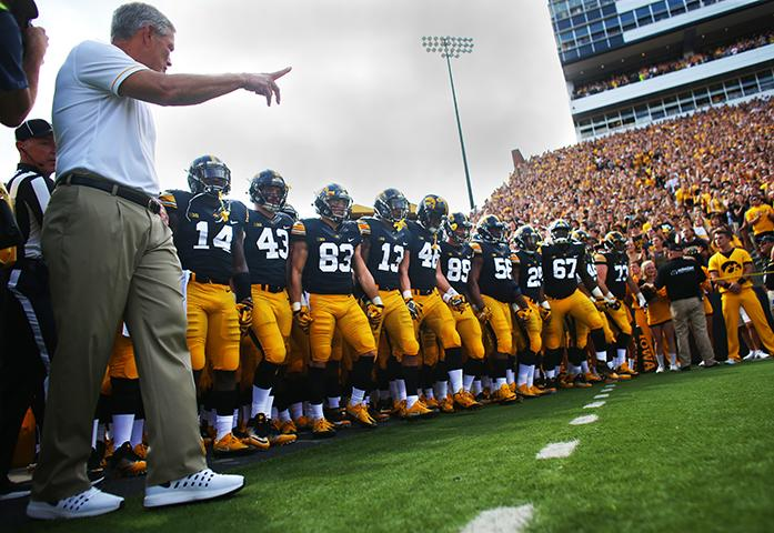 Iowa head coach Kirk Ferentz tells the players to run on the field to start the Iowa-Miami (Ohio) game at Kinnick on Saturday, Sept. 3, 2017. The Hawkeyes defeated the Redhawks, 45-21. (The Daily Iowan/Margaret Kispert)