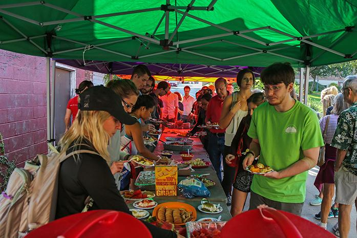 Students and members of the community help themselves to free samples at the Farmer's Market on Wednesday, Sept. 14, 2016. The annual Taste of the Market event gives the public a chance to try various items from vendors for free.  (The Daily Iowan/Anthony Vazquez)