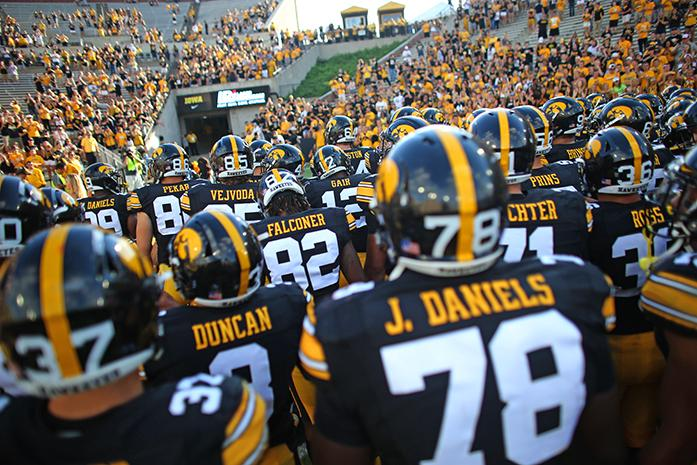 The Iowa team runs off the field after the Iowa-Miami (Ohio) game at Kinnick on Saturday, Sept. 3, 2017. The Hawkeyes defeated the Redhawks, 45-21. (The Daily Iowan/Margaret Kispert)