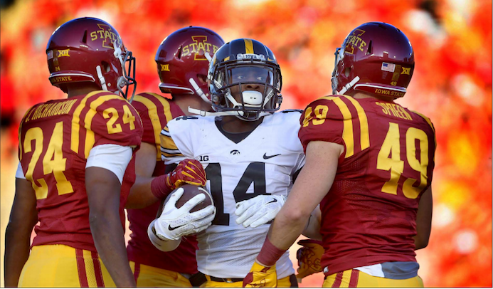 Iowa defensive back Desmond King stands in a crowd of Iowa State players after a punt return in Jack Trice Stadium on Sept. 12, 2015. The Hawkeyes defeated the Cyclones, 31-17. (The Daily Iowan/File Photo)