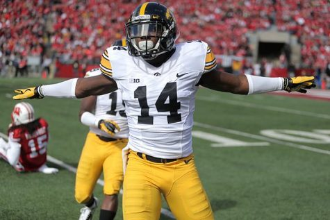 Iowa defensive backs Desmond King celebrates a stopped play against Wisconsin at Camp Randall Stadium in Madison, Wisconsin on Saturday, Oct. 3, 2015. The Hawkeyes defeated the Badgers, 10-6. (The Daily Iowan/Rachael Westergard)