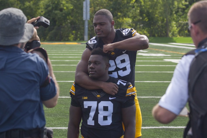 Iowa running back LeShun Daniels and offensive guard James Daniels horse around during the Iowa football media day  fields on Aug. 8. The Daniels are brothers. (The Daily Iowan/Joseph Cress)