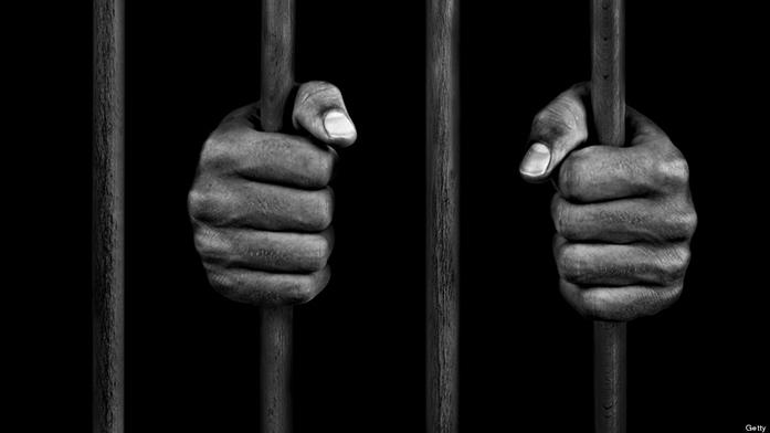 hands+of+a+prisoner+on+prison+bars