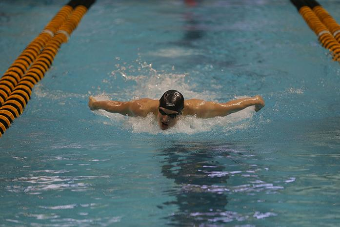 Jerzy Twarowski of Iowa races during the third heat of the mens 200 fly on Sunday, Dec. 6, 2015. in the Campus Recreation and Wellness Center. Twarowski finished first with a time of 1:17.04. Iowa won the invitational for the second year in a row. (The Daily Iowan/Brooklynn Kascel)