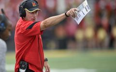 FILE - In this Sept. 3, 2016, file photo, Maryland head coach DJ Durkin gestures during the second half of an NCAA football game against Howard in College Park, Md. Though first-year coach DJ Durkin is known for his defensive prowess, Maryland is unbeaten because of an attack that has rung up 123 points, second-most in school history after three games. (AP Photo/Nick Wass, File)
