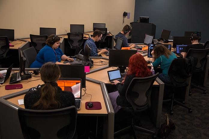 In this file photo, locals from around the area work on computers  at the Iowa City Public Library on Nov. 2, 2016. After winning a battle in 2015, Net neutrality is again under fire from Bit Telecom and, this time around, the Trump administration. (The Daily Iowan/Anthony Vazquez, File)
