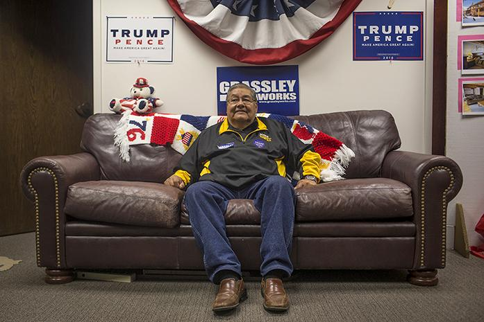 Voter mobilizer for the Republican Party of Iowa Johnathan Orteha sits on a coach in the Republican headquarters in Bettendorf. (The Daily Iowan/ Jordan Gale)